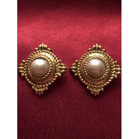 Boucles d'oreilles Yves Saint Laurent Perles