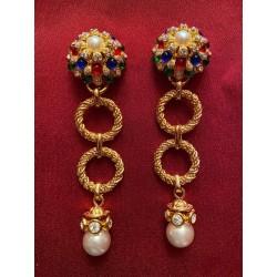 Boucles d'oreilles Chanel...